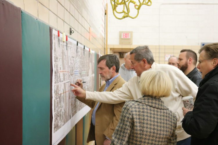 T-R PHOTO BY ADAM SODDERS An open house on the Highway 14 Corridor Study was held at the Woodbury Elementary cafeteria Tuesday evening. Those interested were invited to view displays and ideas for the study, and visitors were able to point out on a map where they think improvements need to be made.