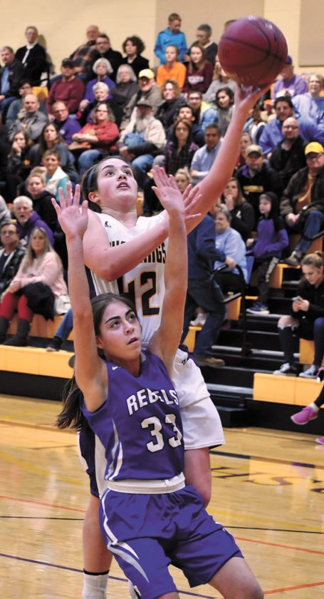 T-R PHOTO BY THORN COMPTON • East Marshall sophomore Olivia Terrones (42) rises up for a layup over Gladbrook-Reinbeck freshman Belen Ellenberger during the Mustangs' win over the Rebels in Le Grand on Tuesday night.