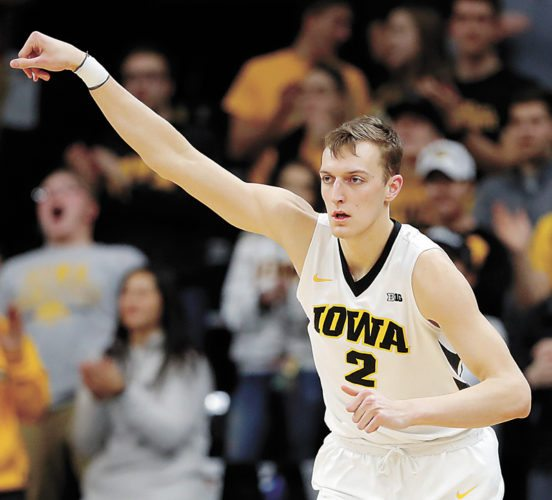 AP PHOTO • Iowa forward Jack Nunge reacts after making a 3-pointer during the first half of Tuesday's Big Ten Conference basketball game against Minnesota at Carver-Hawkeye Arena in Iowa City.