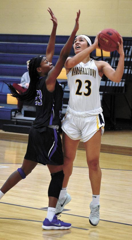T-R PHOTO BY THORN COMPTON • Marshalltown Community College sophomore Loralei Siliga (23) attempts a shot in the paint while Iowa Western's Miya Bull defends during the Tigers' loss to the Reivers at home on Wednesday.