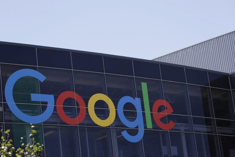 FILE - This Tuesday, July 19, 2016, file photo shows the Google logo at the company's headquarters in Mountain View, Calif. Google parent Alphabet Inc. reports earnings Thursday, Feb. 1, 2018. (AP Photo/Marcio Jose Sanchez, File)