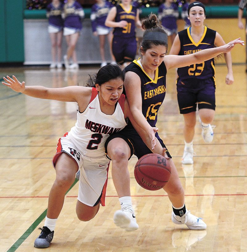 T-R PHOTO BY ROSS THEDE • East Marshall's Emily Terrones, right, and Meskwaki's Deandra Navarro (2) battle for a loose ball during the second half of Thursday's non-conference girls' basketball game at Meskwaki Settlement School.