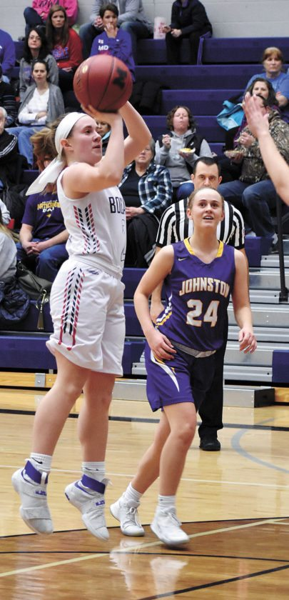 T-R PHOTO BY THORN COMPTON • Marshalltown junior Alyvia Chadderdon, left, pulls up for a shot at the top of the key while Johnston's Macy Thompson looks on during the second half of the Bobcats's loss to the Dragons on Friday in the Roundhouse.