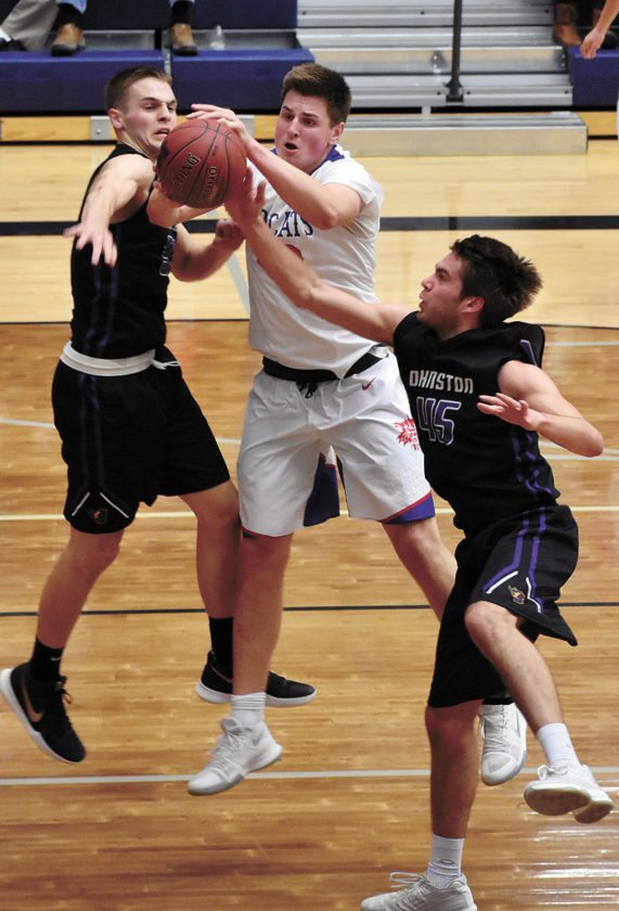 T-R PHOTO BY THORN COMPTON • Marshalltown senior Luke Appel, center, fights for the ball with Johnston's Nathan Newcomb (45) and Camden Vander Zwaag during the first half of the Bobcats' 54-51 loss to the No. 9 Dragons at home on Friday.