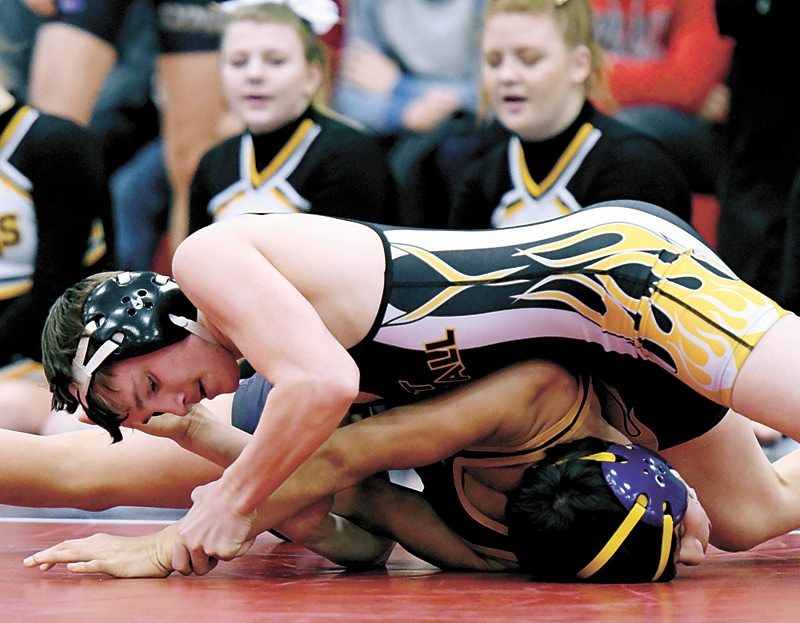 PHOTO BY TROY BANNING/WEBSTER CITY DAILY FREEMAN JOURNAL • West Marshall senior Hunter Pfantz, top, nears the pinfall victory over Webster City's Nick Gasca during Saturday's Class 2A Sectional 16 wrestling tournament at Ballard High School in Huxley. Pfantz, a three-time state qualifier, won the 126-pound with a pair of pins to advance to next weekend's district meet in Webster City.