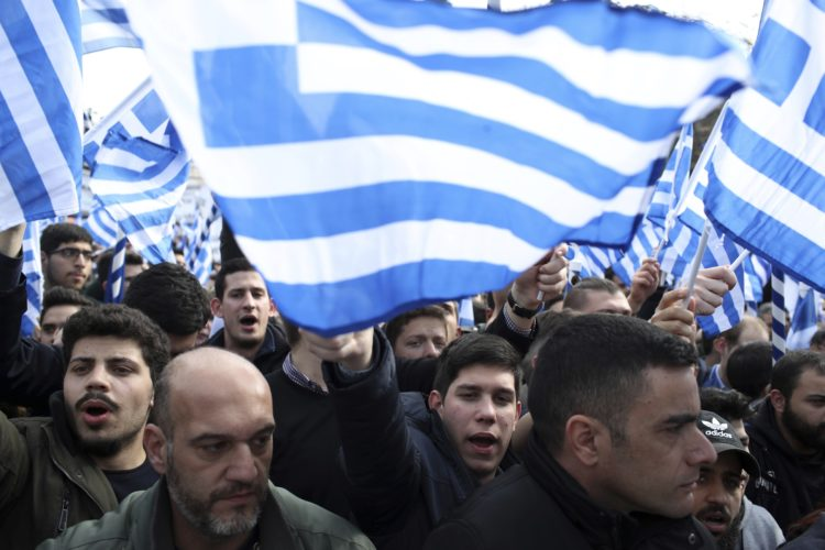 Protesters shout slogans during a rally in Athens, Sunday, Feb. 4, 2018. Protesters gather in the Greek capital for a massive rally to protest a potential Greek compromise in a dispute with neighboring Macedonia over the former Yugoslav republic's official name. (AP Photo/Petros Giannakouris)