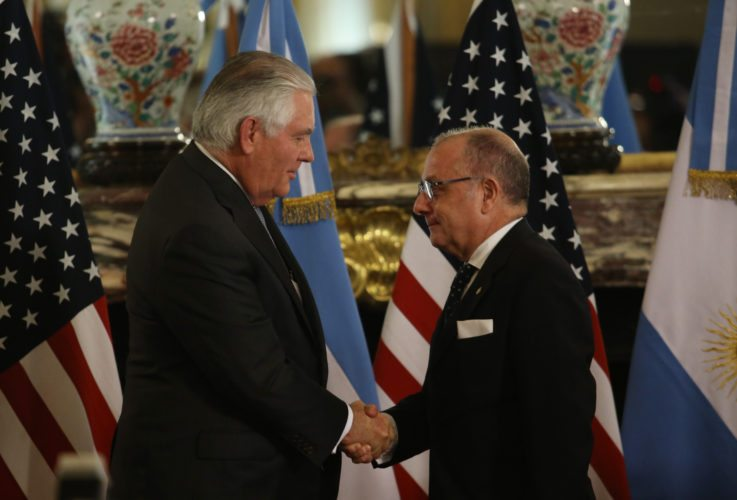U.S. Secretary of State Rex Tillerson, left, and Argentine Foreign Minister Jorge Faurie shake hands after giving joint news conference in Buenos Aires, Argentina, Sunday, Feb. 4, 2018. Tillerson is on a weeklong trip to Latin America. (AP Photo/Sebastian Pani)
