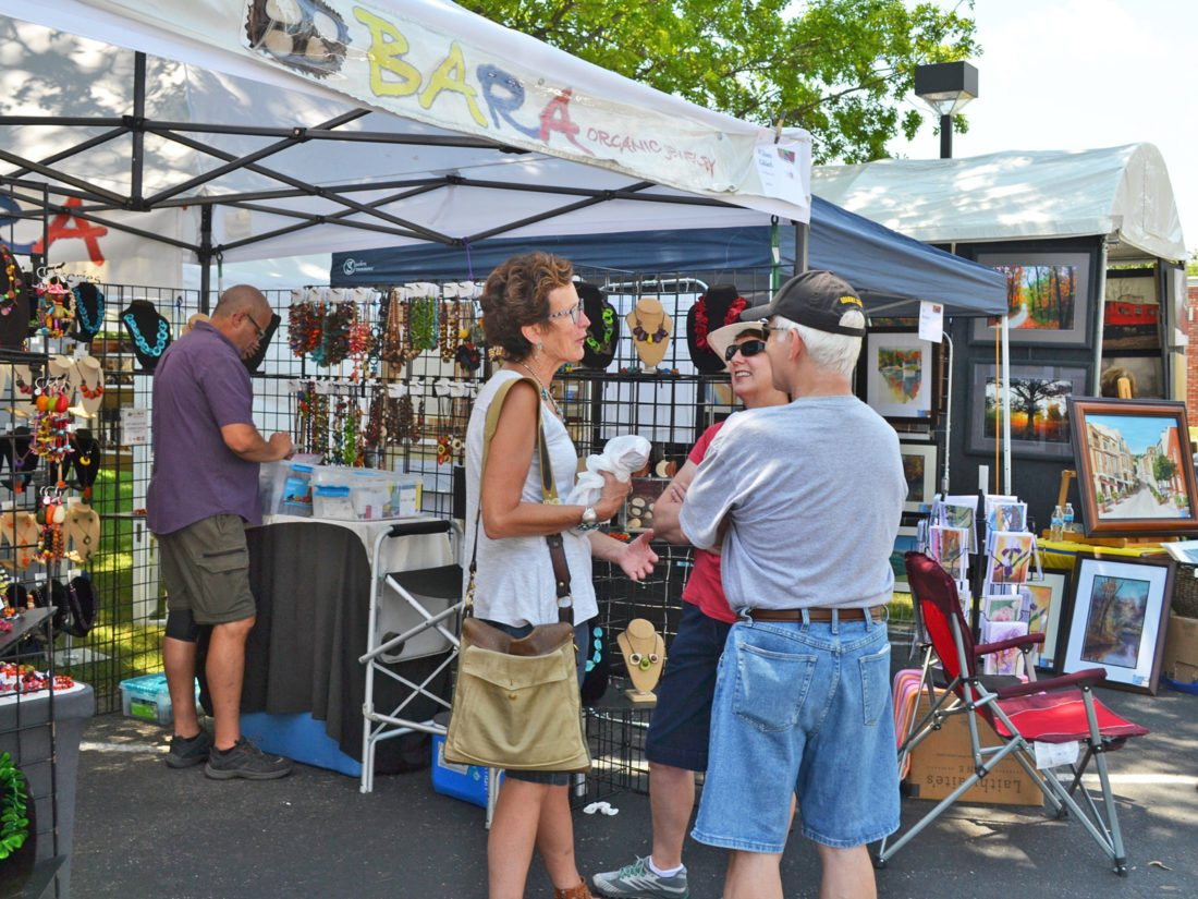 """T-R FILE PHOTO The Marshalltown Art Festival, formerly known for many years as the Linn Creek Arts Festival, will be moved from the grounds of the Fisher Community Center to downtown Marshalltown on July 21. """"The festival name was changed to brand the community of Marshalltown alongside one of its most popular events,"""" Alliance Director Amber Danielson said."""