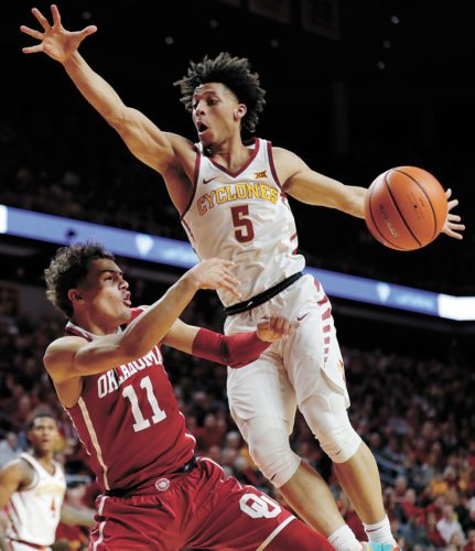 AP PHOTO • Oklahoma guard Trae Young (11) is fouled by Iowa State guard Lindell Wigginton (5) during the first half of their Big 12 Conference basketball game Saturday in Ames. Iowa State won 88-80.