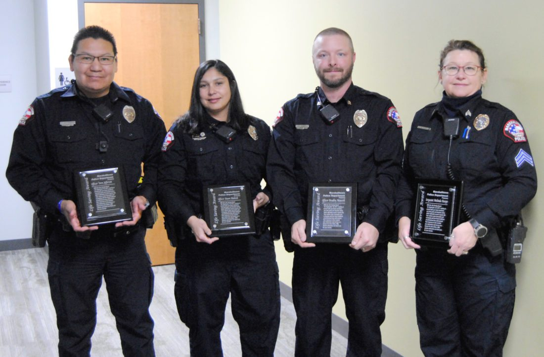 T-R PHOTO BY JEFF HUTTON The Marshalltown Police Department presented four of its members with its Lifesaving Award Monday night during the Marshalltown City Council meeting. From left: Officers Vern Jefferson, Dawn Blahnik, Brad Mauseth and Sgt. Melinda Ruopp.
