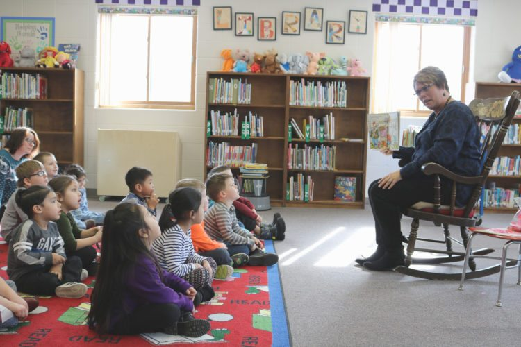 T-R PHOTO BY ADAM SODDERS District officials say preschool offers students a chance to get accustomed to being in a classroom and learning with other students. All six Marshalltown elementary schools offer tuition-free preschool, and the 2018-19 school year will bring five half-days of class instead of the current four half-days. These Franklin Elementary preschoolers were enjoying story time Monday afternoon.