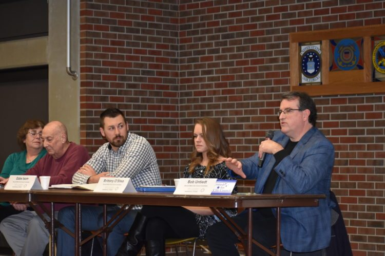 T-R PHOTO By MIKE DONAHEY Second ward city council candidate Brittany O'Shea, fourth from left, answers a question posed by the moderator at the Marshalltown Chamber of Commerce Candidate Forum Tuesday night at the Iowa Veterans Home. Looking on from left are fellow candidates Leigh Bauder, Jay Carollo, Gabe Isom and Bob Untiedt. The special election to fill the seat is Feb. 27.