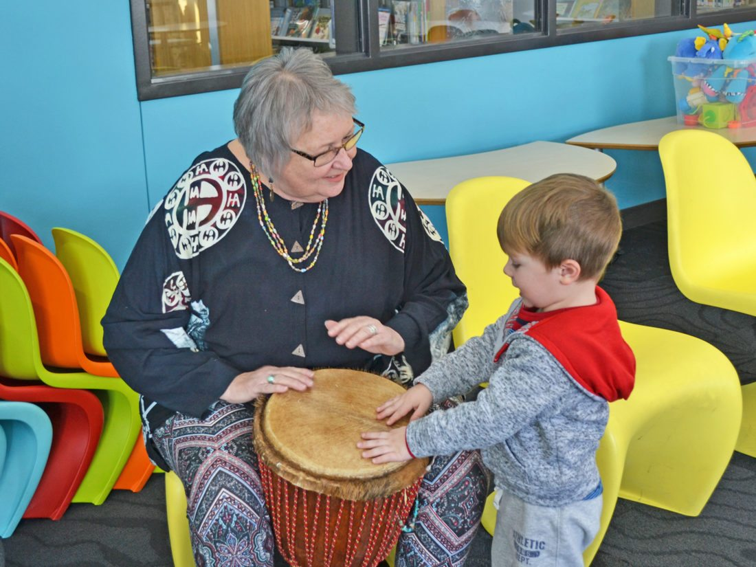 T-R PHOTO BY SARA JORDAN-HEINTZ On Friday at 4 p.m. and 6 p.m. at the Marshalltown Public Library, youngsters and their guardians are invited to participate in a free, Family Drum Circle event, led by musician/artist Linda Harvey. She will bring around 70 percussion instruments for participants to use, and people are welcome to bring their own. Here, Harvey drums along with a young onlooker, who got a sneak peak of what to expect.