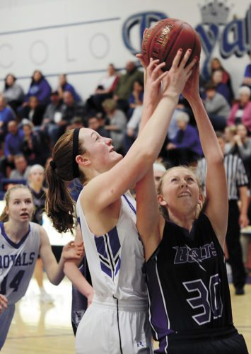 T-R PHOTO BY ROSS THEDE • Colo-NESCO senior Molly Barten, center, snares a rebound over Baxter's Sydney Schmidt (30) during the first half of Tuesday's Class 1A Region 3 quarterfinal in Colo.