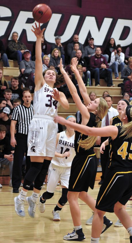 T-R PHOTO BY THORN COMPTON • Grundy Center junior Kylie Willis (34) shoots over BCLUW sophomore Madison Ubben (45) during the second half of the Spartans' regional quarterfinal win over the Comets on Tuesday evening.