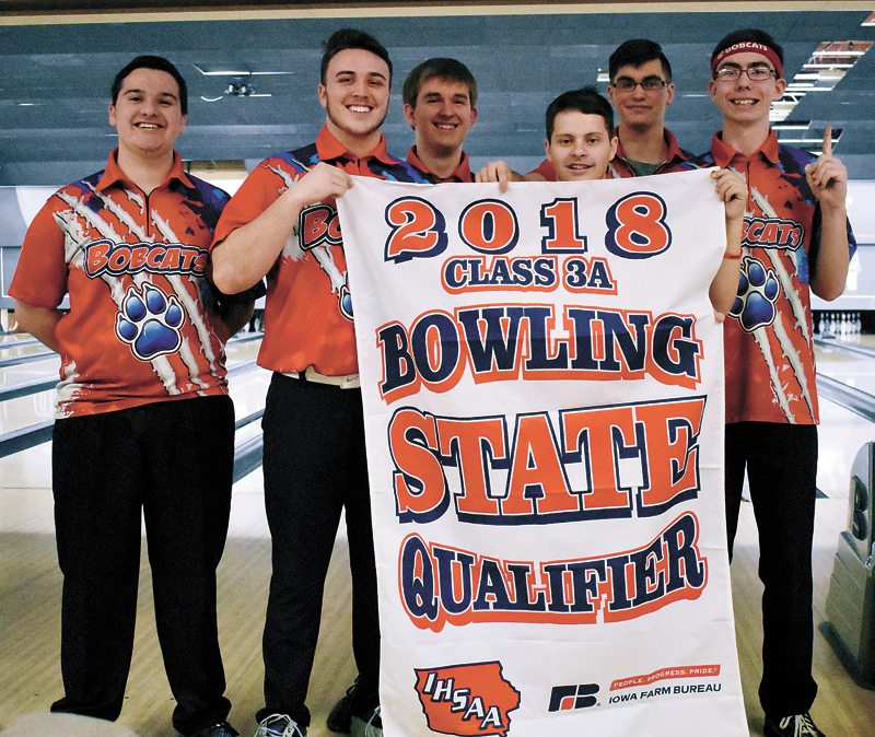 T-R PHOTO BY THORN COMPTON • The Marshalltown boys bowling team poses with their state qualifier banner after winning its district meet in Marshalltown on Tuesday. Pictured are, from left, Kamrin Chizek, Jonathan McKeever, Joshua Arment, Ray Wiegand, Richie Thomas and Lucas Kramer.