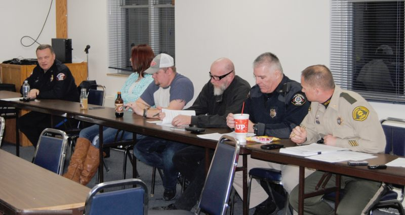 T-R PHOTO BY JEFF HUTTON Members of the Marshall County Communications Commission's Technical Oversight Board met this week to discuss a variety of issues. Pictured, from left, Marshalltown Police Chief Mike Tupper, Marshall County 911 dispatchers Tiffany Manship Eibs and Dan McCready, Melbourne Police Chief Mike Ball, State Center Police Chief Jeff Bunn and Marshall County Chief Sheriff's Deputy Joel Phillips.