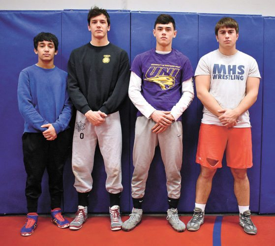 T-R PHOTO BY THORN COMPTON • Marshalltown is sending four boys to compete in the Iowa High School State Wrestling Championships in Des Moines starting today. Pictured are, from left, sophomore Zach Bitker and seniors Brian Trowbridge, Logan Baccam and Decker Mann.