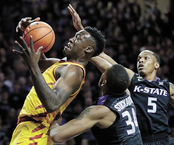 AP PHOTO • Iowa State forward Cameron Lard (2) rebounds against Kansas State forward Levi Stockard III (34) and guard Barry Brown (5) during the first half of an NCAA college basketball game Saturday in Manhattan, Kan.
