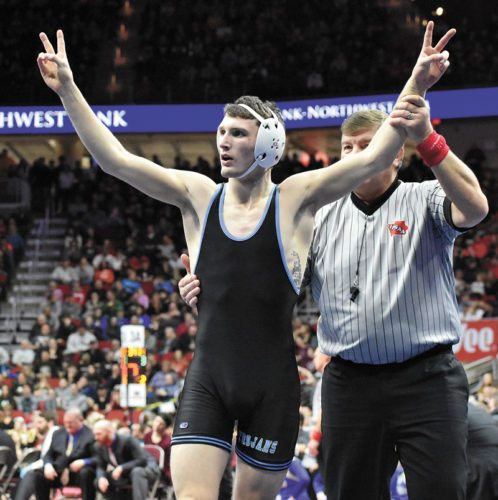 T-R PHOTO BY THORN COMPTON • South Tama County senior Isaac Judge raises two fingers on both hands to the crowd after winning his second-straight Class 2A state championship at 152 pounds on Saturday night in the Iowa High School State Wrestling Championships. The title makes Judge the first ever Trojans with multiple championships.
