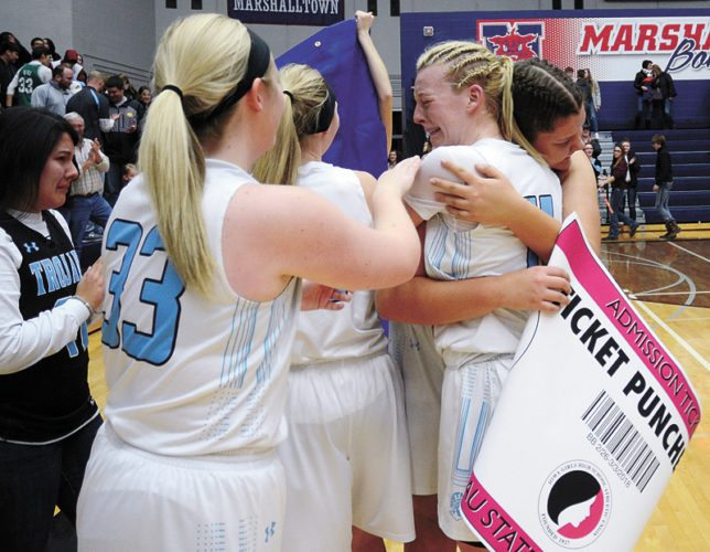 T-R PHOTO BY ROSS THEDE • South Tama County's Jessica Musgrave (11) shares an emotional hug with Zoee Buffalo after the Trojans defeated West Marshall 38-36 in Saturday's Class 3A Region 7 championship game at the Marshalltown Roundhouse. Musgrave had 26 points, 10 rebounds and seven steals for STC.