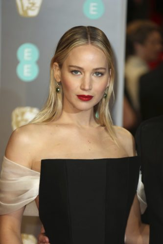 Actress Jennifer Lawrence poses for photographers upon arrival at the BAFTA 2018 Awards in London, Sunday, Feb. 18, 2018. (Photo by Joel C Ryan/Invision/AP)