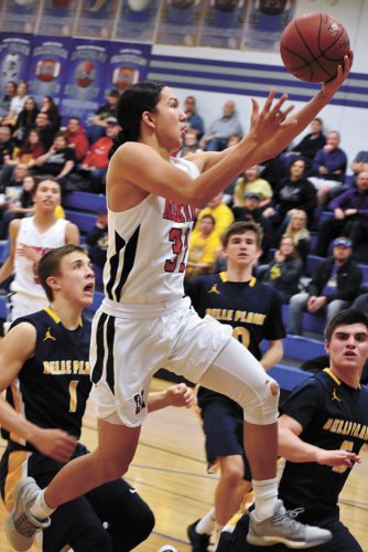 T-R PHOTO BY THORN COMPTON • Meskwaki senior guard Jarius Bear sails past the Belle Plaine defense for a layup during Tuesday's Class 1A District 7 semifinal at Gladbrook-Reinbeck High School in Reinbeck. Bear scored a team-leading 17 points in the Warriors' 57-40 win.