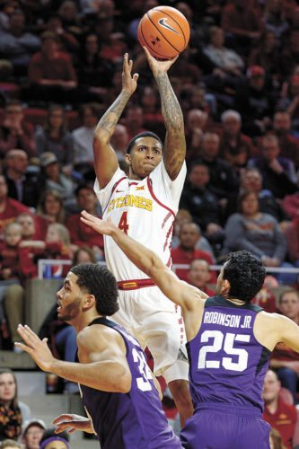 AP PHOTO • Iowa State's Donovan Jackson (4) shoots a 3-pointer over TCU's Alex Robinson (25) during the first half of Big 12 Conference basketball game Wednesday in Ames.