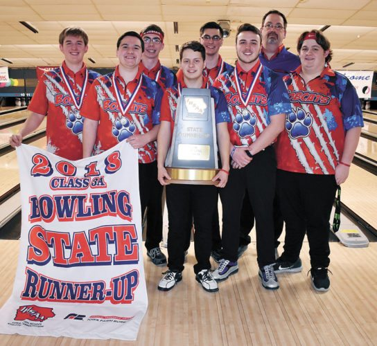 T-R PHOTO BY THORN COMPTON • The Marshalltown boys bowling team poses with its second-place trophy and banner after finishing runner-up at the Class 3A state tournament for the second-straight year on Wednesday. Pictured, from left, are Joshua Arment, Kamrin Chizek, Lucas Kramer, Ray Wiegand, Richie Thomas, Jonathan McKeever, head coach Roger Taylor Sr. and Carson Potter.
