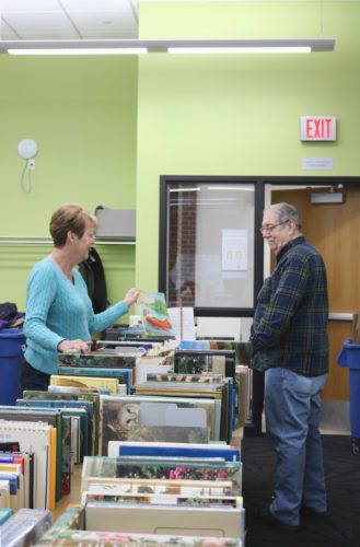 Volunteers were hard at work throughout the week preparing for the Friends of the Marshalltown Public Library book sale this weekend. The group organized the hundreds of books, magazines and movies in VHS and DVD format, CDs and more in the library meeting room Friday. The sale begins today from 9 a.m. to 3 p.m. and continues Sunday from 1-4 p.m. at the library, 105 W. Boone St