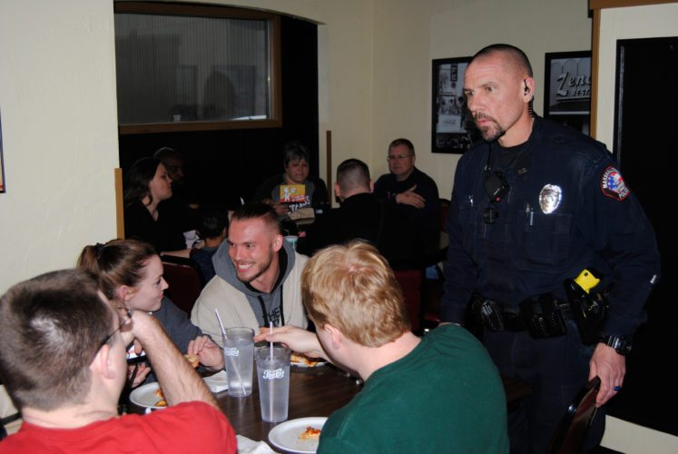 "As part of the Marshalltown Police Department's ""Coffee with the Cop"" program, Zeno's hosted ""Pizza with the Police"" Saturday afternoon and evening. Here, MPD Officer Dave Danielson speaks with patrons at the event"