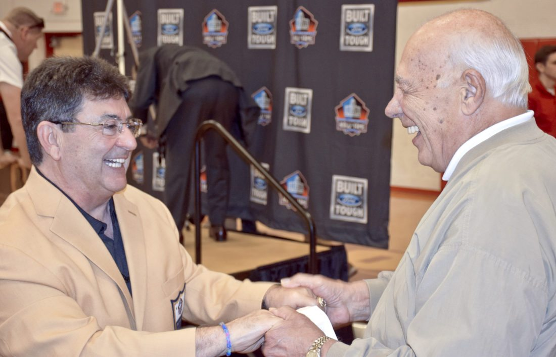 Tribune Chronicle / John Vargo  Former San Francisco 49ers owner Edward J. DeBartolo Jr., left, is greeted by Cardinal Mooney High School athletic director Don Bucci Wednesday at the school. DeBartolo, a 1964 graduate of Mooney, was honored for his induction into the Pro Football Hall of Fame in August.