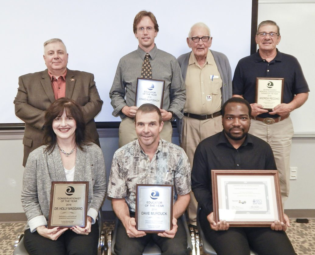Tribune Chronicle / Bob Coupland The Trumbull Soil and Water Conservation District held its annual awards dinner recently at the Trumbull County Agriculture and Family Education Center in Cortland. In the front row from left are Dr. Holly Maggiano, Conservationist of the Year; David Murduck, Conservation Educator of the Year; and Jeloni Lampley, Earth Team Volunteer of the Year. In the back are Ed Agler, Volunteer of the Year; Craig Klotzbach, Conservation Educator of the Year; Dale Parker, a member of first board of supervisor in the 1950s; and Andrew Pecchio, George Sharec Memorial Conservation Award.