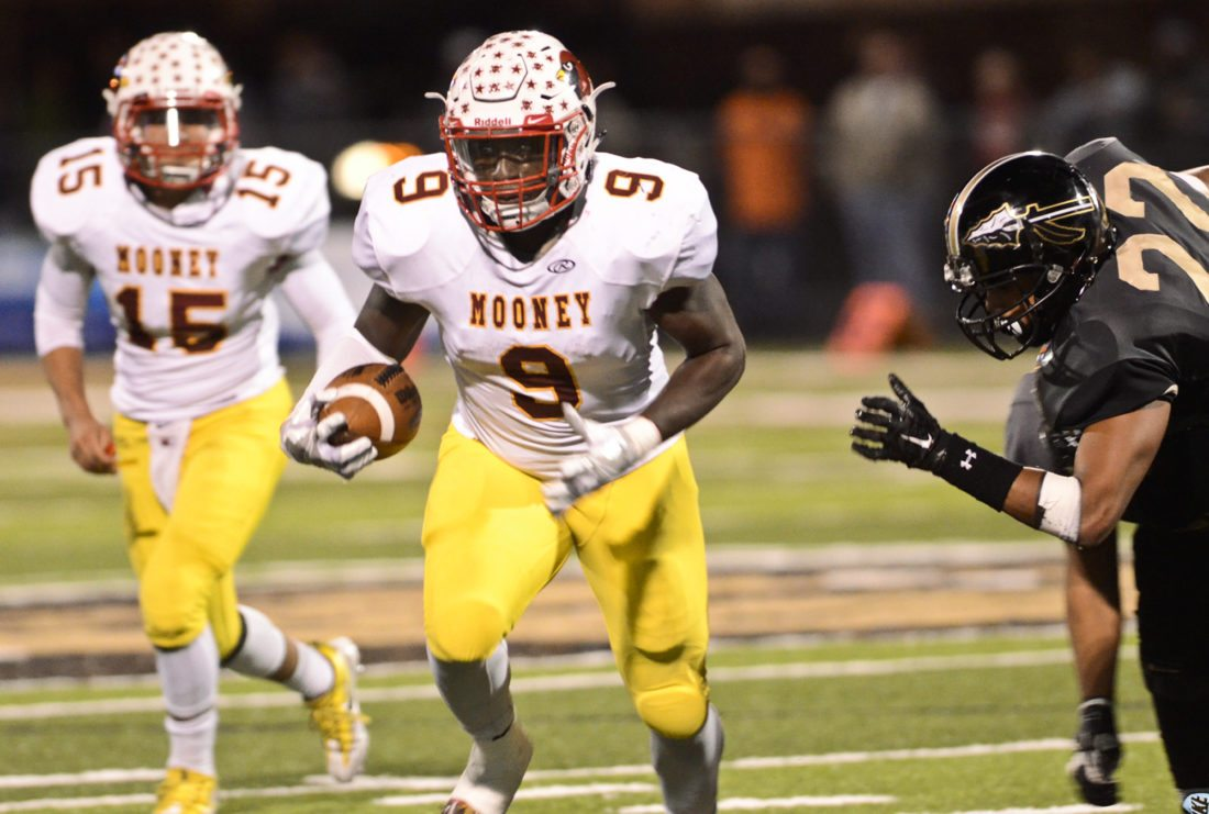 Mooney's #9 Jaylen Hewlett, center, breaks to the outside after taking the hand-off from Mooney QB #15 Antonio Page, left, as WGH's #22 Elijah Burch, right, pursues during 1st half action...by R. Michael Semple