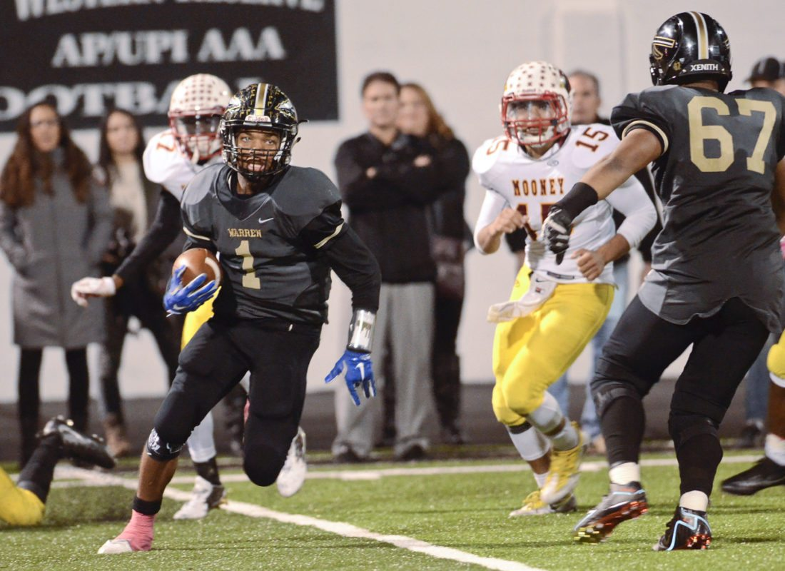 WGH QB #1 Lynn Bowden weaves his way through Mooney's secondary and than rushed down the sideline for a 2nd Qt. TD...Mooney's #15 Antonio Page and WGH #67 Jowan Poole follow the action...by R. Michael Semple
