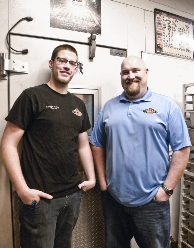 Brian Zupp, 24, of Warren, left, stands outside the cooler at the Texas Roadhouse in Niles where he works as the restaurant's main meat cutter with his boss, Chad Smith, a managing partner with the company.