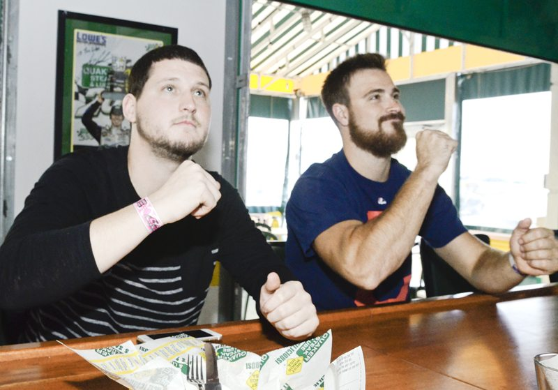 101816...R TRIBE FANS...Bazetta...10-18-16... Cody Dillon, left, and Todd Collins, both of Newton Falls, cheer on the Cleveland Indians against the Toronto Blue Jays Tuesday at Quaker Steak and Lube in Bazetta...by R. Michael Semple