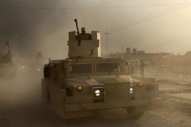 An Iraqi military humvee advances towards the city of Mosul, Iraq, Wednesday, Oct. 19, 2016. A senior Iraqi general on Wednesday called on Iraqis fighting for the Islamic State group in Mosul to surrender as a wide-scale operation to retake the militant-held city entered its third day. (AP Photo)