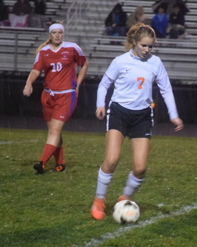 Tribune Chronicle / John Vargo Newton Falls' Sidney Drake kicks the ball as Lordstown's Kaylynn Higginbotham follows during Thursday's Division III sectional bracket final in Newton Falls.