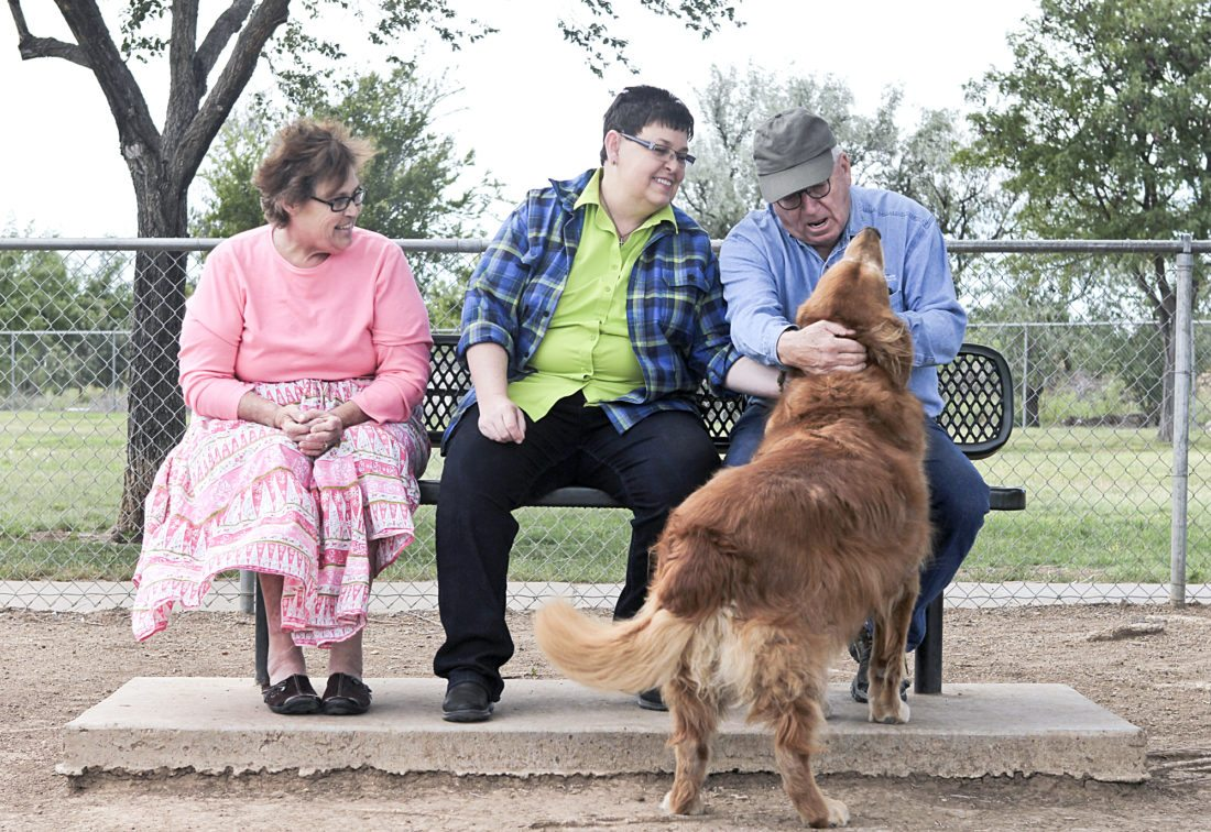 In this Sept. 15, 2016 photo, Bryan Clancy, a 10-year-old golden retriever with terminal cancer, spends one of his last visits to to the John Stiff Memorial Dog Park with his human companions Joyce Conner, from left, Shirley Cole and Tom Cole in Amarillo, Texas. The day will come. There will be a final romp at the dog park, a final hunting trip, a final scratch at the bathroom door, a final mouse left on the porch or a final snuggle before bedtime. For many pet owners, this is the day they refuse to consider. It is the day when life turns painfully upside-down from when paws pattered contentedly through the home. It is the day when a beloved pet leaves this world. (Lauren Koski/The Amarillo Globe News via AP)