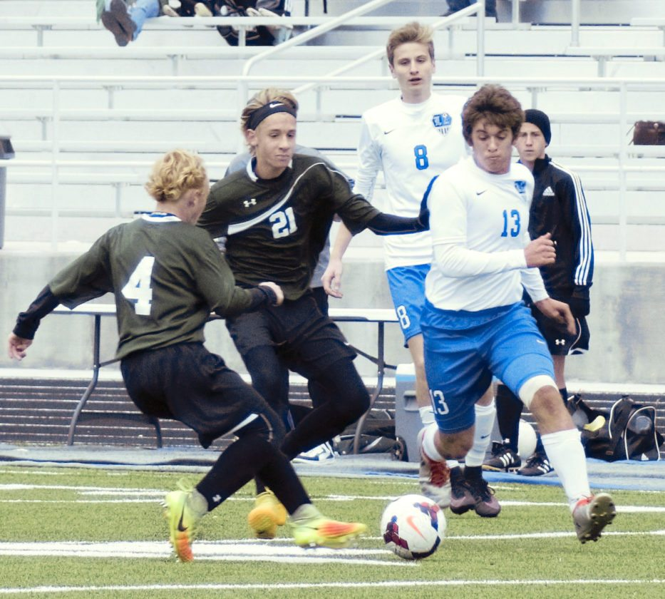 Tribune Chronicle / Bob Ettinger Jarrett Collins (13) of Lakeview beats West Branch defenders Stevie Stinson (4) and Luke Johnson in Division II sectional tournament action at Don Richards Memorial Stadium on Saturday afternoon.