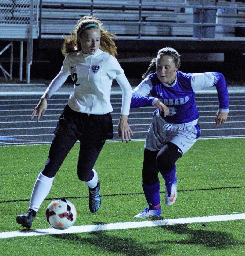 Tribune Chronicle / Bob Ettinger Bella Kakiou, left, of Lakeview dribbles toward the corner as Kyleigh Johnson of Hubbard defends in Division II district semifinal action at Don Richards Memorial Stadium on Monday night. Lakeview won, 4-0.