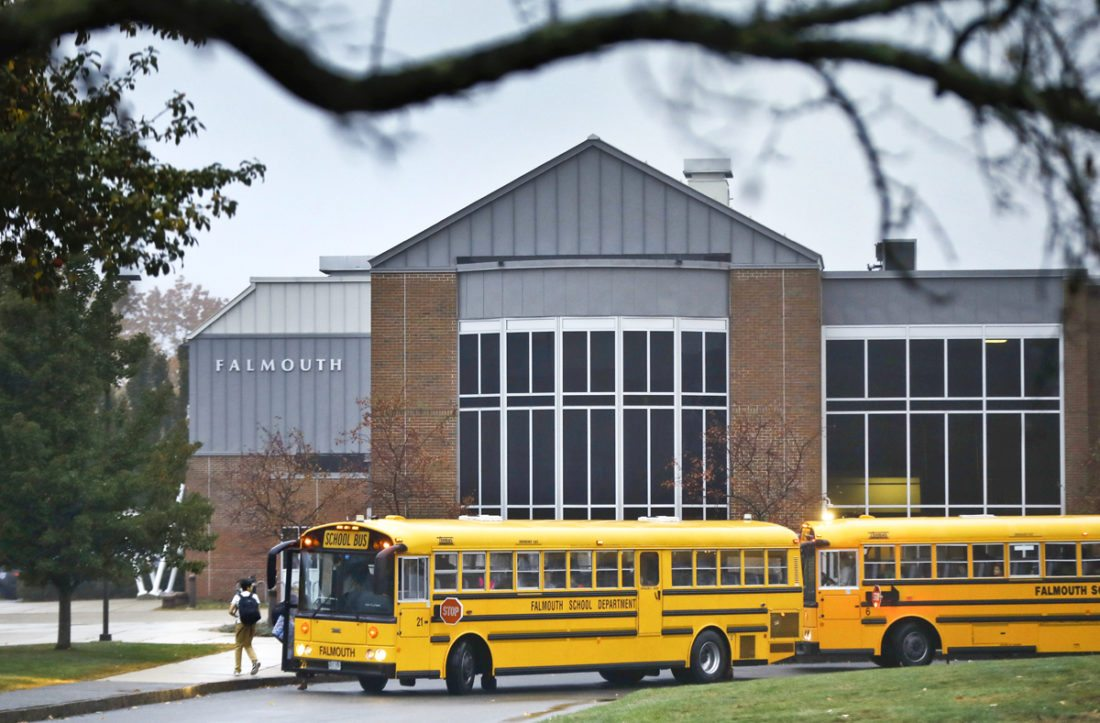 In this Oct. 21, 2016 photo, students arrive at Falmouth High School in Falmouth, Maine. The town of Falmouth is one of several municipalities around the country that has canceled school on Election Day to avoid placing children at risk in case the heated rhetoric spills into confrontations or even violence at the polling places. (AP Photo/Robert F. Bukaty)