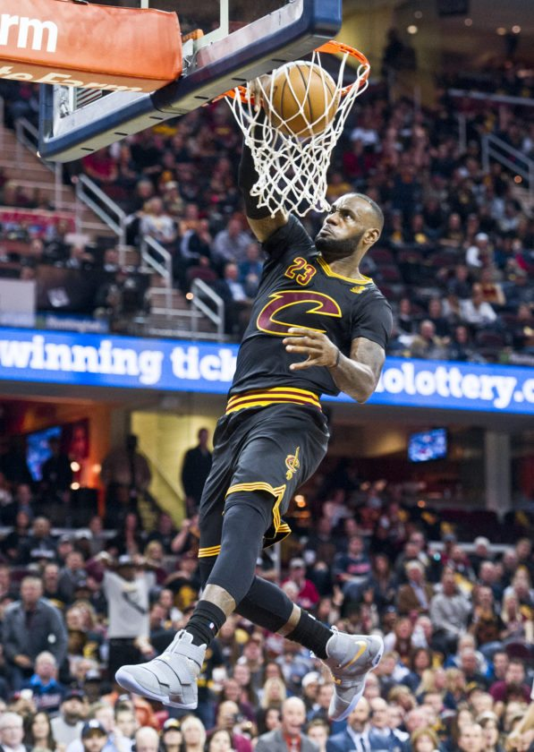 Cleveland Cavaliers' LeBron James  dunks against the New York Knicks during the first half a basketball game in Cleveland, Tuesday, Oct. 25, 2016. (AP Photo/Phil Long)