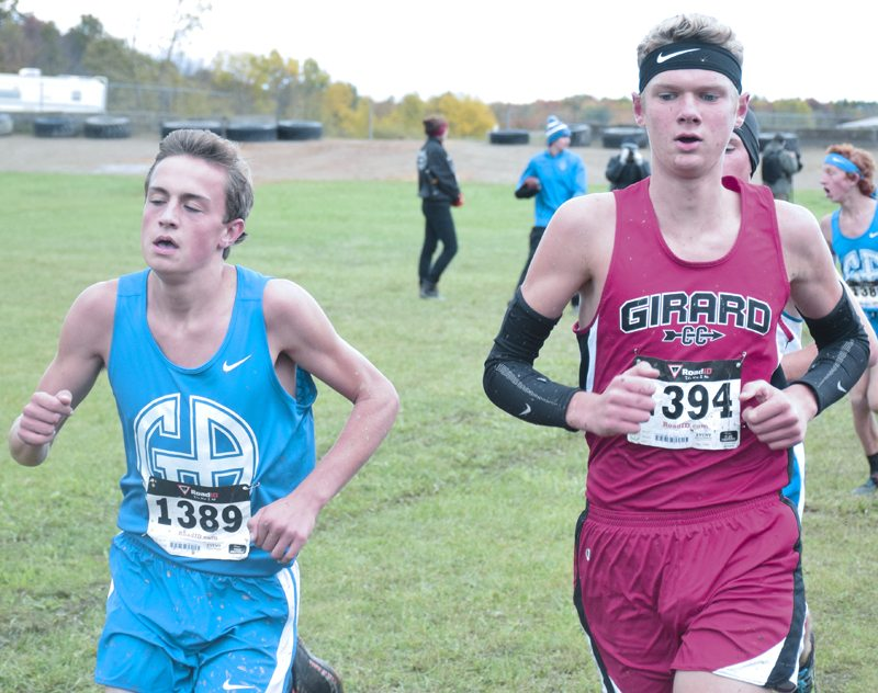 Tribune Chronicle / John Vargo Girard's Derek Basinger, right, goes after a state qualifying spot on Saturday.
