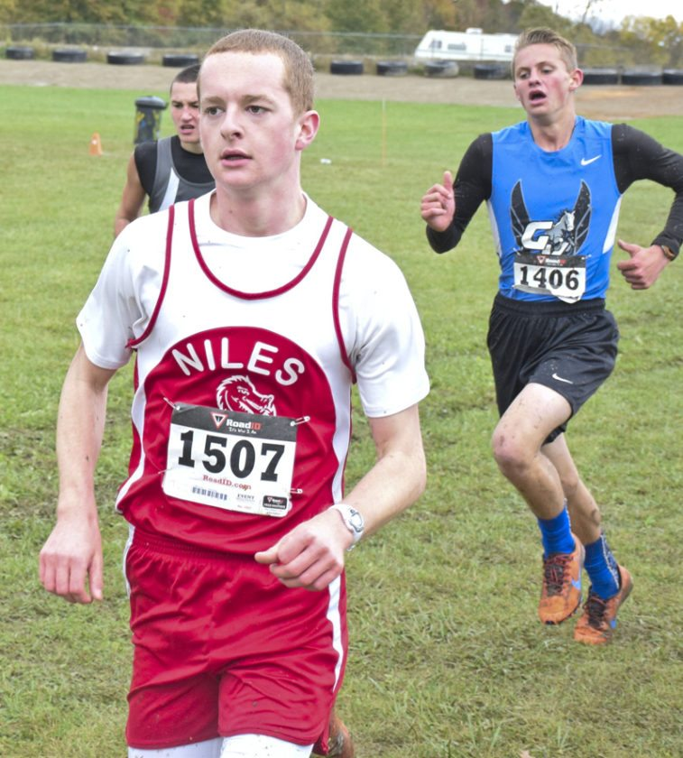 Tribune Chronicle / John Vargo Kevin Dubaj of Niles runs Saturday in the regional cross country meet at Boardman.