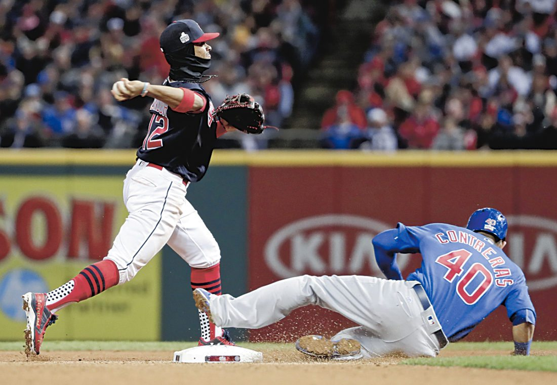 Cleveland Indians shortstop Francisco Lindor, left, forces Willson Contreras out at second after Jorge Soler hit into a double play during the fourth inning of Game 2 of the Major League Baseball World Series Wednesday, Oct. 26, 2016, in Cleveland. (AP Photo/Matt Slocum)