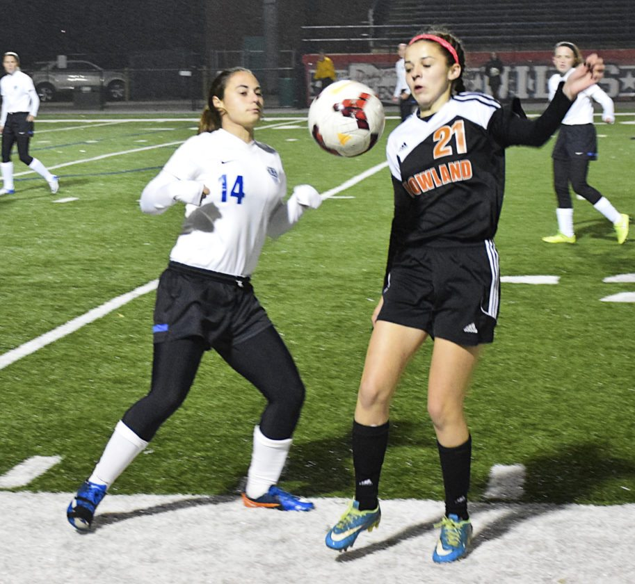 Tribune Chronicle / Joe Simon Howland's Ashley Chambers, right, tries to control the ball while Lakeview's Tori Depizzo defends during a Division II district final at Niles' Bo Rein Stadium. Howland won, 3-0.