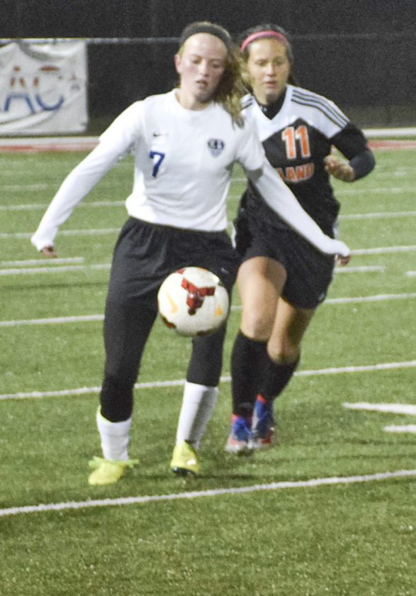 Tribune Chronicle / Joe Simon Lakeview's Isabel Wilson (7) dribbles down field as Howland's Isabello Merlo chases during a Division II district final Thursday.