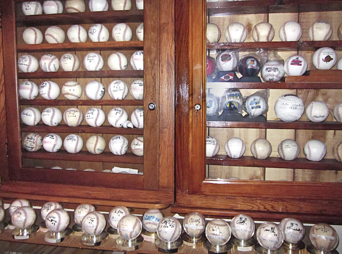 These are some of the about 150 autographed baseballs in the collection of Bernie Zickefoose, 84, of Southington. Most were acquired during spring training games in Florida.